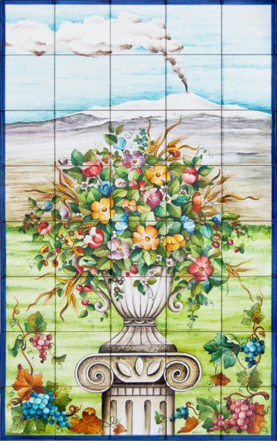 composizione di mattonelle decorate a mano con decoro Etna e fiori