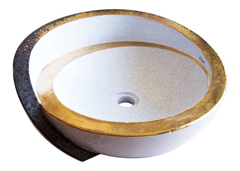 Lavello in pietra lavica rotondo con rifiniture in oro
