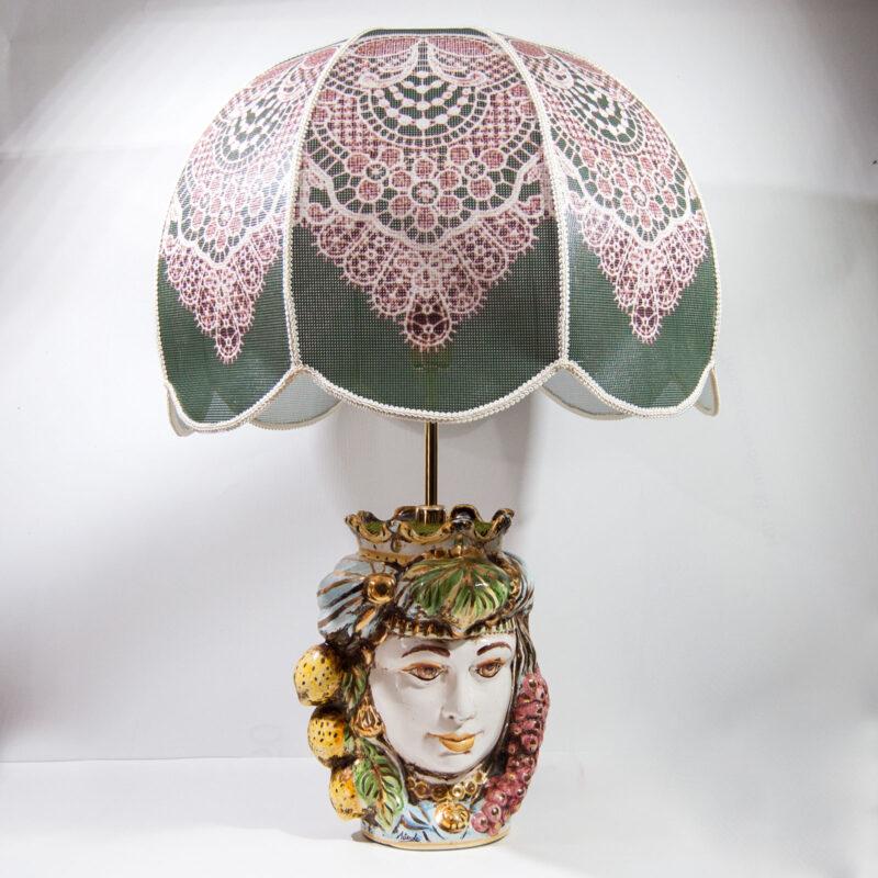 Lume con base testa di moro in ceramica decorata a mano