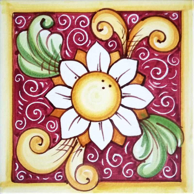 mattonella ceramizzata con fiore dipinto a mano