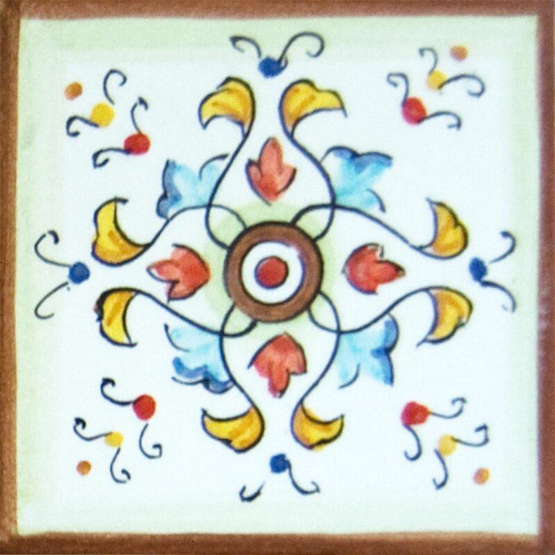 mattonella in ceramica con decoro realizzato a mano