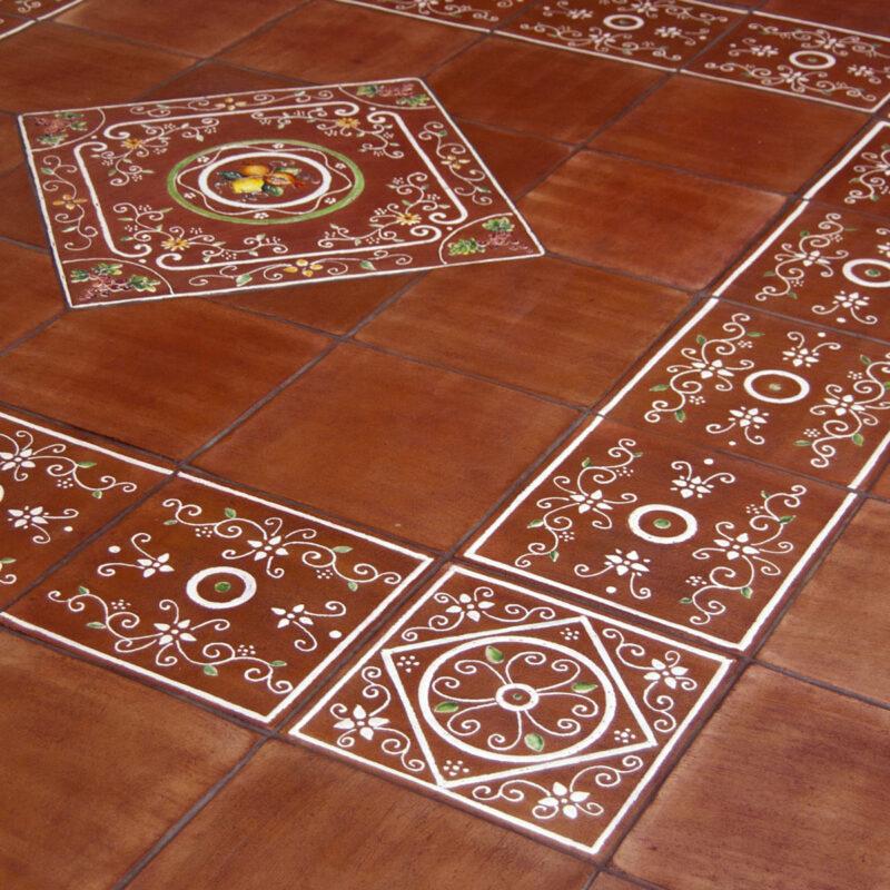 pavimento in cotto decorato a mano realizzato su misura