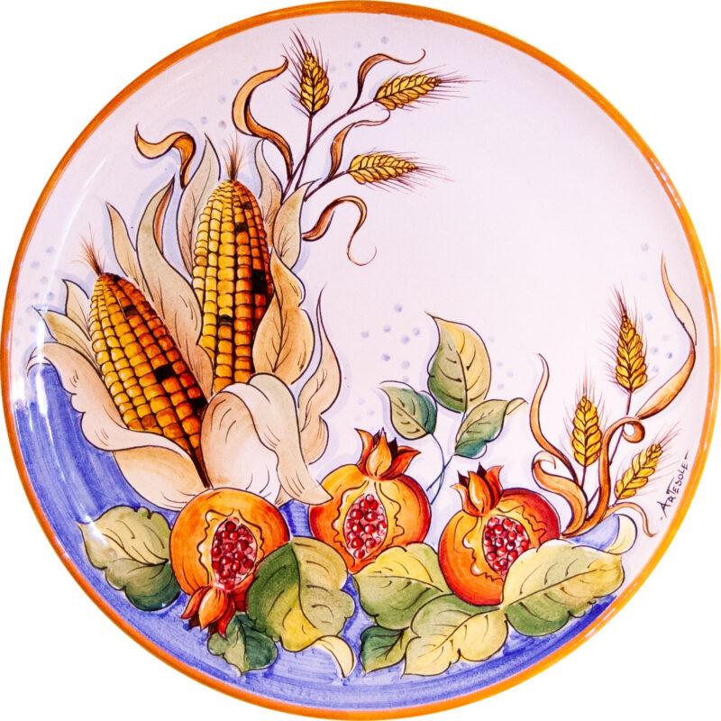 Piatto per cucina da muro in ceramica decorata a mano