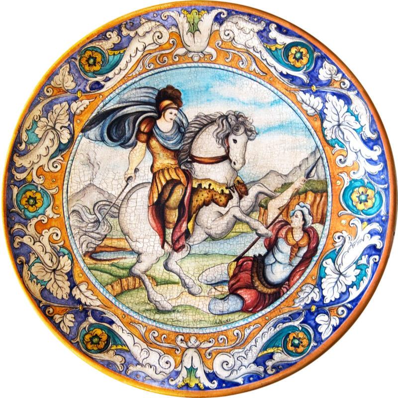 Piatto da muro in ceramica con illustrazione di San Giorgio decorato a mano