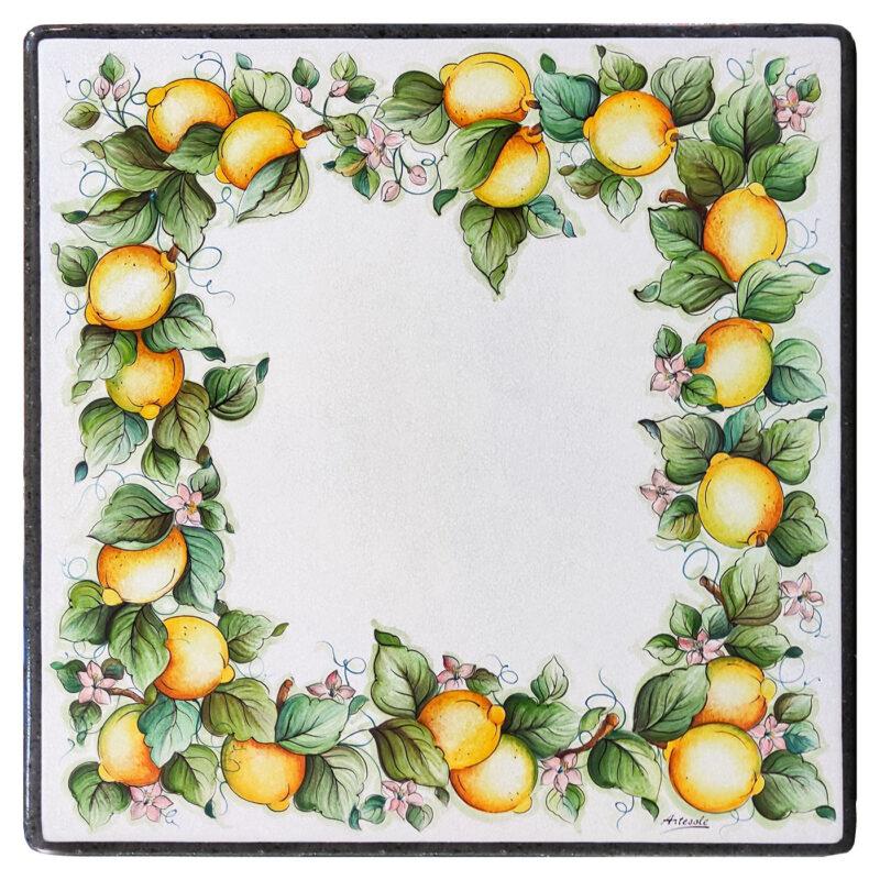 Tavolo in pietra lavica con decoro limoni di Caltagirone