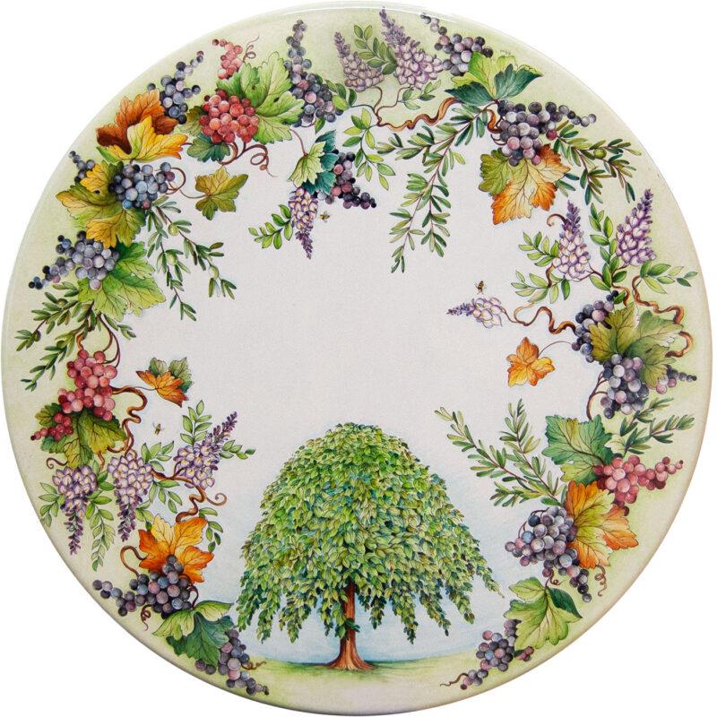 tavolo in pietra lavica rotondo con decoro glicine, uva, albero olmo