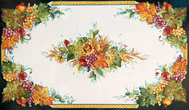 Tavolo in pietra lavica con decoro in stile Caltagirone