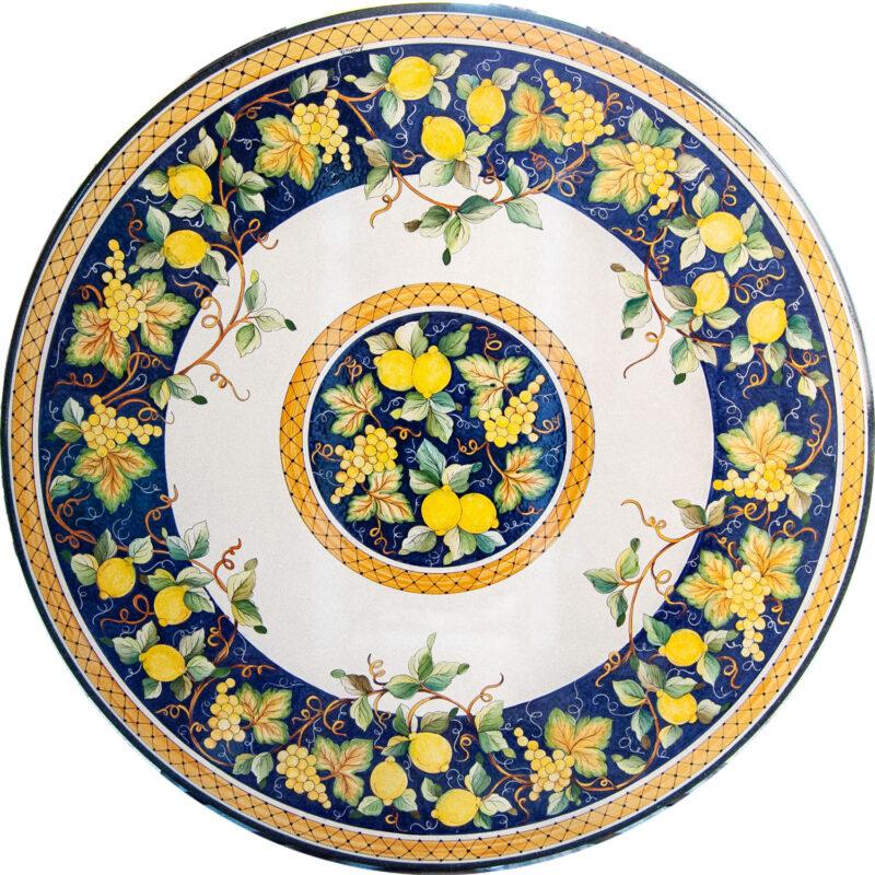 Tavolo in pietra lavica con decoro uva e limoni
