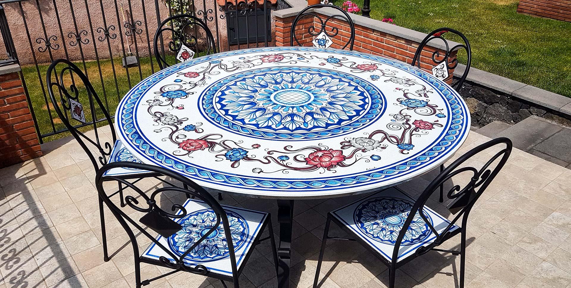 Tavoli in Pietra Lavica decorati a mano - info e prezzi | Artesole
