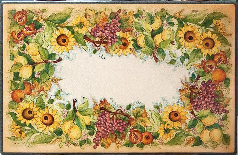 Tavolo in pietra lavica con girasoli, melograni e limoni. Decorato a mano in stile Caltagirone