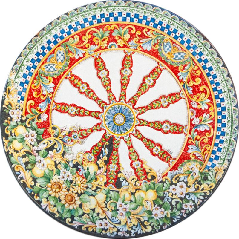 tavolo in pietra lavica decorato a mano con decorazione ruota di carretto con girasoli e limoni