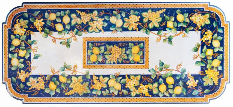 Tavolo in pietra lavica con decoro uva e limoni decorati a mano
