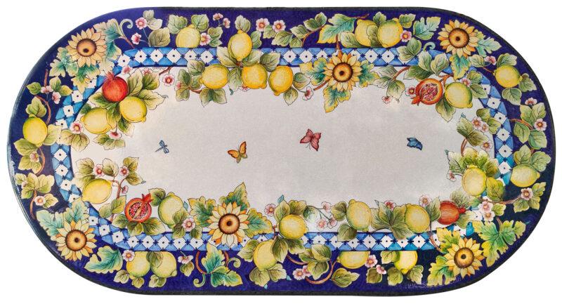 Tavolo in pietra lavica con decoro limoni, girasoli, melograni e farfalle