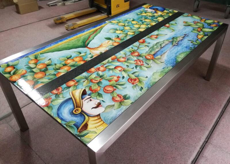 tavolo moderno in pietra lavica con pupi siciliani