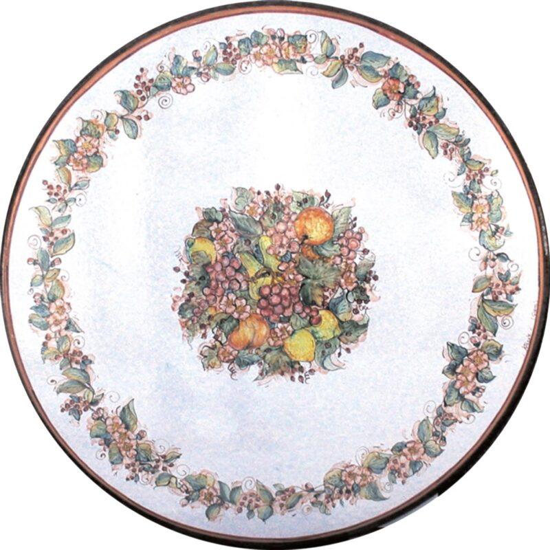 tavolo in pietra lavica rotondo con decoro fiori e frutta