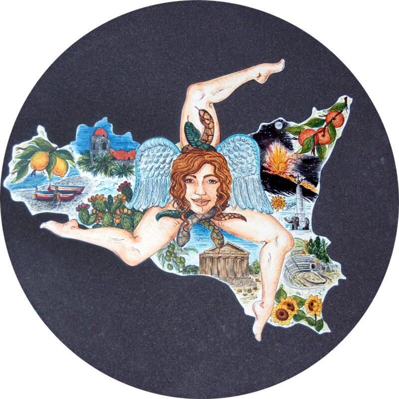 tavolo in pietra lavica rotondo dipinto a mano con decoro trinacria, sicilia