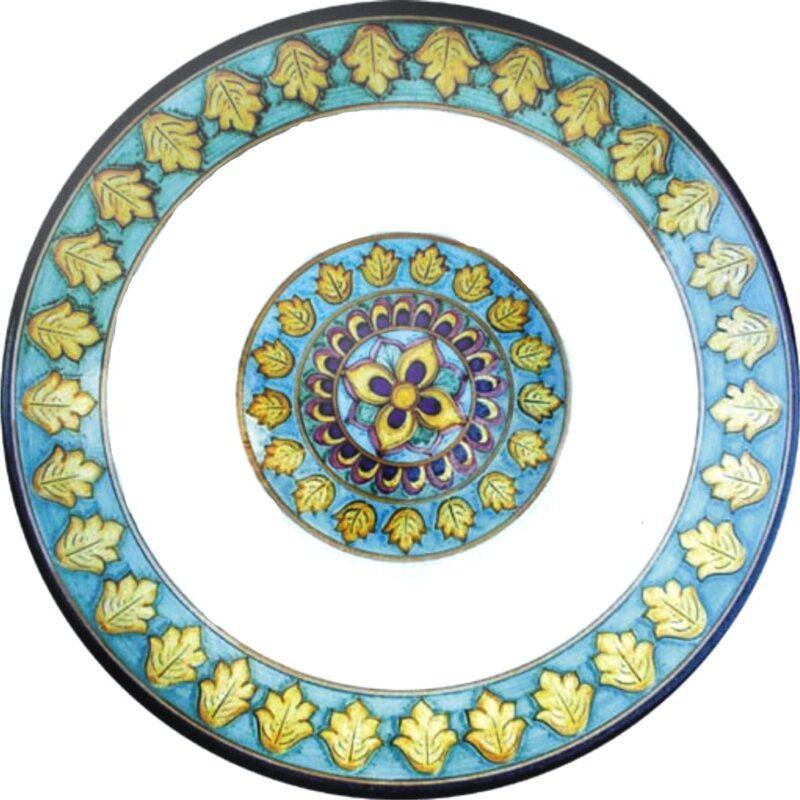 tavolo rotondo in pietra lavica con decoro giro foglie