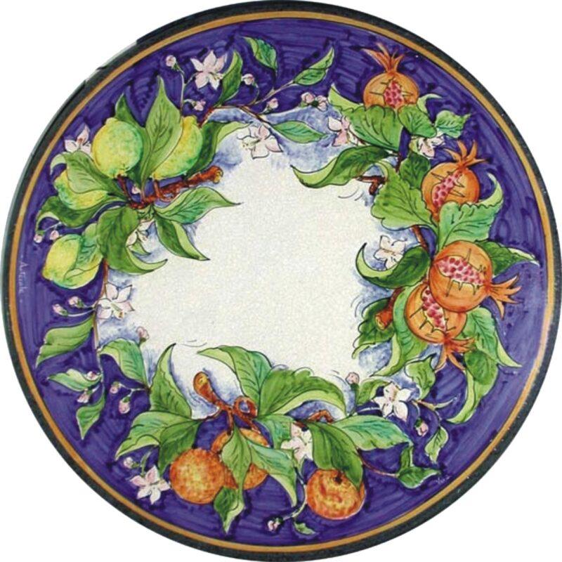 tavolo in pietra lavica con decoro tris di frutta