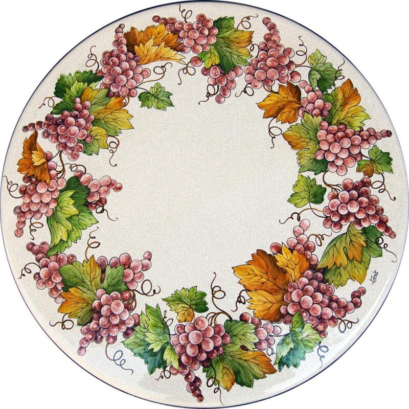 tavolo in pietra lavica rotondo con decoro uva dipinto a mano