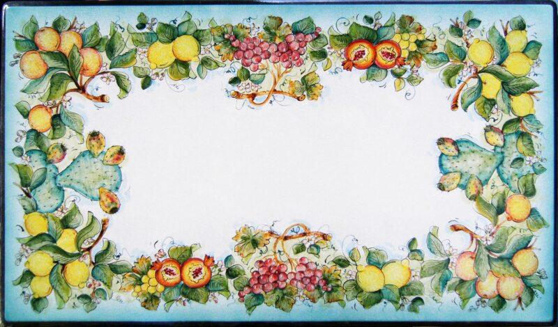 Tavolo rettangolare in pietra lavica decorato a mano con decoro limoni, melograni, uva rossa e gialla, arance e fichi d'India