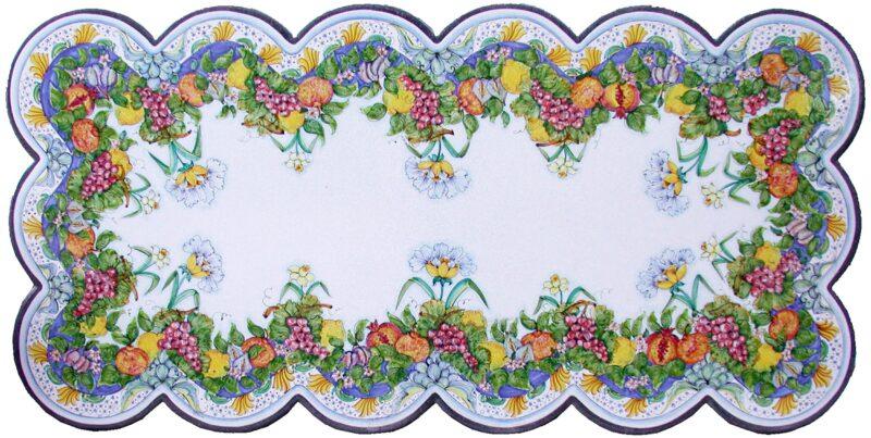 Tavolo smerlato in pietra lavica decorato a mano