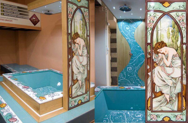 vasca da bagno con doccia, realizzata in pietra lavica dell'Etna decorata a mano